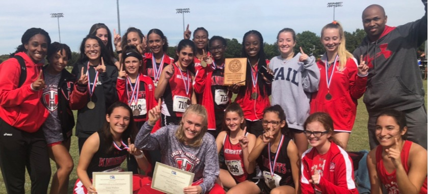 HHHS Cross Country Girls Team holding up awards