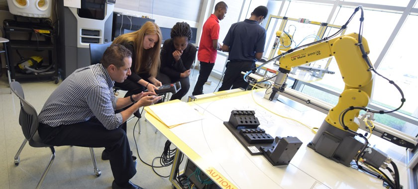 Career Center students program a robotic arm