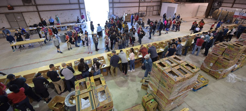 Students, soldiers and a whole community collect food