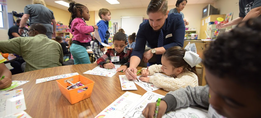 Volunteer dads join their students at Saegert Elementary