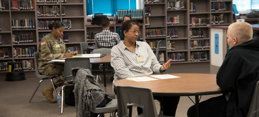 Interviewers give feedback during the mock interviews at Audie Murphy Middle School