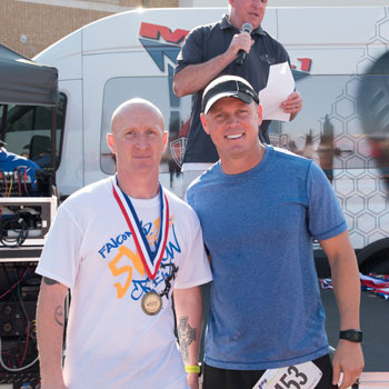 Dr. Craft poses with Richard Littlefield, the first place finisher of the 5K.